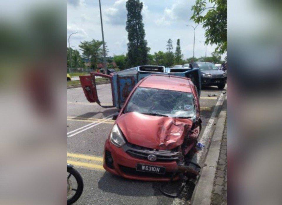 Keadaan kereta Myvi dan van yang terbabit dalam kemalangan di Bandar Kirara, petang tadi.